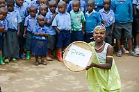 RWANDA, Musanze, Ruhengeri, village Janja, dance performance at school, program reconciliation after genocide, girl holds a bowl with the word peace/ RUANDA, Aussoehnung nach dem Genozid, Tanzverfuehrung in einer Dorfschule, Maedchen mit Schale mit dem Wort Frieden