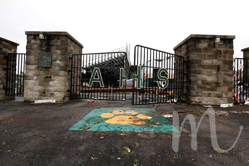 Photo By Chris Mackler: The entrance to Basil Rutter Field at Athens High School in The Plains, Ohio, on the morning of Friday, Sept. 17, 2010. An unconfirmed tornado ripped through The Plains, Ohio Thursday Sept. 16, 2010, causing downed power lines, uprooted trees, overturned mobile homes and significant damage to Athens High School. Community members and emergency workers survey the situation and begin cleanup on the morning of Friday, Sept. 17, 2010 in The Plains, Ohio.