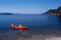 Ocean Canoeing along the Shores of Montague Harbour Provincial Marine Park on Galiano Island, in the Southern Gulf Islands, British Columbia, Canada