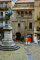 Spain, Segovia. In the old city center; shops, two couples, umbrella. Segovia Castilla Y Leon Spain.