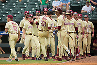 Dylan Busby (28) of the Florida State Seminoles celebrates with his teammates after scoring the go ahead run against the North Carolina Tar Heels during the 2017 ACC Baseball Championship Game at Louisville Slugger Field on May 28, 2017 in Louisville, Kentucky.  The Seminoles defeated the Tar Heels 7-3.  (Brian Westerholt/Four Seam Images)