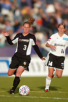 Christie Pearce of the New York Power being trailed by Dagny Mellgren of the Boston Breakers during their May 18th game at Mitchel Athletic Complex in Uniondale, NY. The Power lost 2-1.