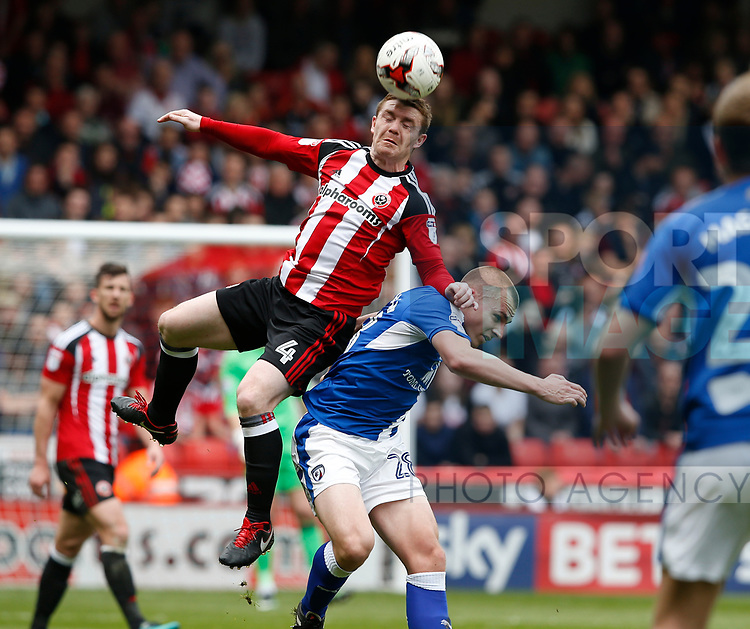 John Fleck of Sheffield Utd in action with Liam Grimshaw of Chesterfield during the English League One match at  Bramall Lane Stadium, Sheffield. Picture date: April 30th 2017. Pic credit should read: Simon Bellis/Sportimage