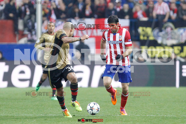 Atletico de Madrid´s Diego Costa (R) and Milan´s Nigel de Jong during 16th Champions League soccer match at Vicente Calderon stadium in Madrid, Spain. March 11, 2014. (ALTERPHOTOS/Victor Blanco)