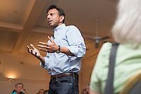 """Louisiana governor and Republican presidential candidate Bobby Jindal speaks to people gathered at his """"Believe Again"""" campaign event at the Governor's Inn and Restaurant in Rochester, New Hampshire. Jindal is campaigning in New Hampshire in advance of the 2016 Republican presidential primary there."""