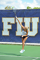 18 March 2012:  FIU's Karyn Guttormsen serves the ball during her doubles match against Columbia's Nicole Bartnik and Lani Alecsiu as the Columbia Lions defeated the FIU Golden Panthers, 5-2, at University Park in Miami, Florida.
