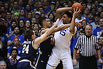 07 February 2015: Duke's Jahlil Okafor (15) is defended by Notre Dame's Zach Auguste (30) and Pat Connaughton (24). The Duke University Blue Devils hosted the University of Notre Dame Fighting Irish at Cameron Indoor Stadium in Durham, North Carolina in a 2014-16 NCAA Men's Basketball Division I game. Duke won the game 90-60.
