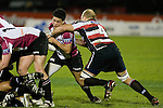 Dave Duley catches Daniel Devereaux at the back of a ruck. Air New Zealand Cup rugby game between Counties Manukau Steelers & North Harbour, played at Mt Smart Stadium on August 10th, 2007. The game ended in a 13 all draw.