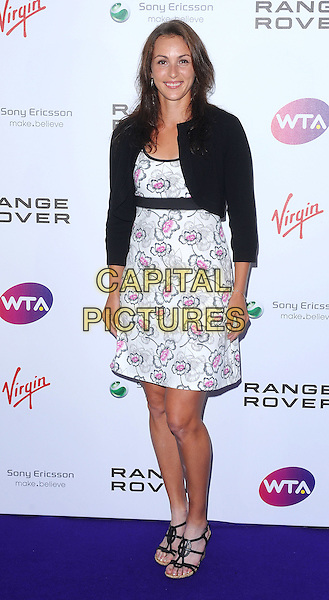 Yaroslava Shvedova.The WTA Tour Pre-Wimbledon Party, The Roof Gardens, Kensington, London, England..16th June 2011.full length dress black pink jacket white patterned floral sandals shoes .CAP/BEL.©Tom Belcher/Capital Pictures.