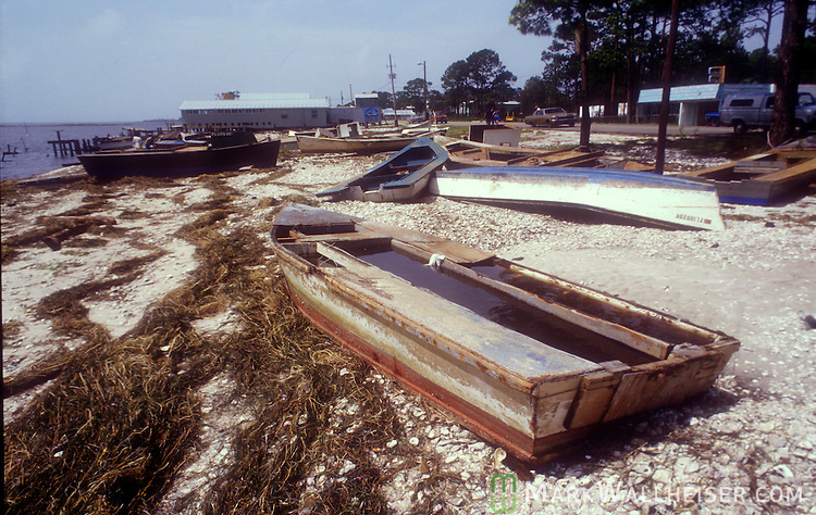 Photograph of the damage after Hurricane Elena churned in the Gulf of Mexico off the coast of the Florida panhandle in September 2, 1985.  Elena was the first major hurricane of the 1985 season and it's unusual path included a loop and went back and fourth along the Florida panhandle as a category 3 storm heavily damaging the Apalachicola, FL oyster industry.  Apalachicola recorded the highest surge and rainfall totals and whatever oyster industry wasn't ruined by Elena was finished off when Hurricane Kate followed  in November of the same season.