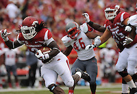 NWA Media/ANDY SHUPE - Arkansas running back Alex Collins heads to the end zone through the Nicholls defense during the second quarter Saturday, Sept. 6, 2014, at Razorback Stadium in Fayetteville