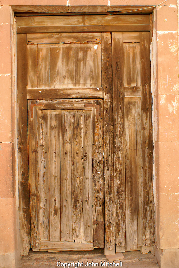 Old wooden door of a house  in the 19th century mining town of Mineral de Pozos, Guanajuato, Mexico.
