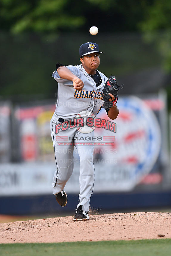 Charleston RiverDogs starting pitcher Rony Garcia (19) attempts a pickoff during a game against the Asheville Tourists at McCormick Field on July 5, 2017 in Asheville, North Carolina. The RiverDogs defeated the Tourists 10-9. (Tony Farlow/Four Seam Images)