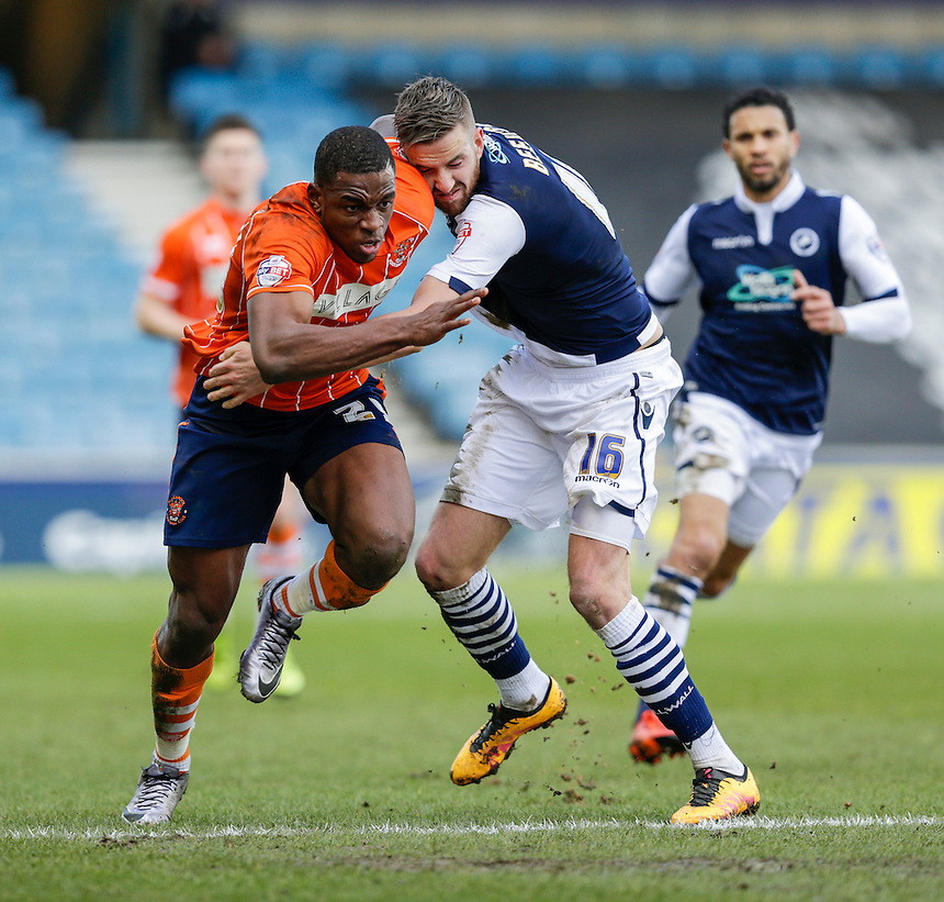 Millwall's Mark Beevers is fouled by Blackpool's Uche Ikpeazu<br /> <br /> Photographer Craig Mercer/CameraSport<br /> <br /> Football - The Football League Sky Bet League One - Millwall v Blackpool - Saturday 5th March 2016 - The Den - Millwall<br /> <br /> &copy; CameraSport - 43 Linden Ave. Countesthorpe. Leicester. England. LE8 5PG - Tel: +44 (0) 116 277 4147 - admin@camerasport.com - www.camerasport.com
