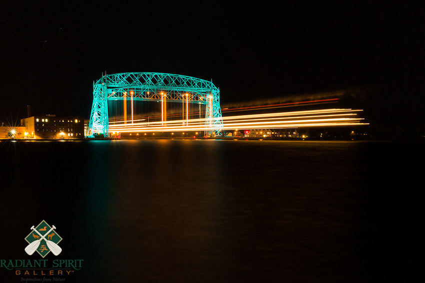Duluth's Aerial Lift Bridge was specially lit in teal to raise awareness about, and remember those whose lives have been touched by, ovarian cancer. During this shoot, the thousand footer, Paul R. Tregurtha, departed, creating a nice light trail as it passed by.