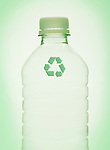Recycling symbol on plastic bottle, studio shot