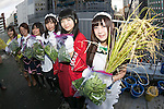 Akihabara maids collect the crops on the roof of the Japan Agricultural Newspaper building in Akihabara district on November 19, 2015, Tokyo, Japan. Every year maids and volunteers from local cafes and stores plant and harvest the crops as a part of the ''Akihabra Vegetable Garden Project'' created by an environmental NPO group Licolita. This year 5 maids from local stores collected rice, rosemary, peppermint, spearmint, and lemon balm. (Photo by Rodrigo Reyes Marin/AFLO)