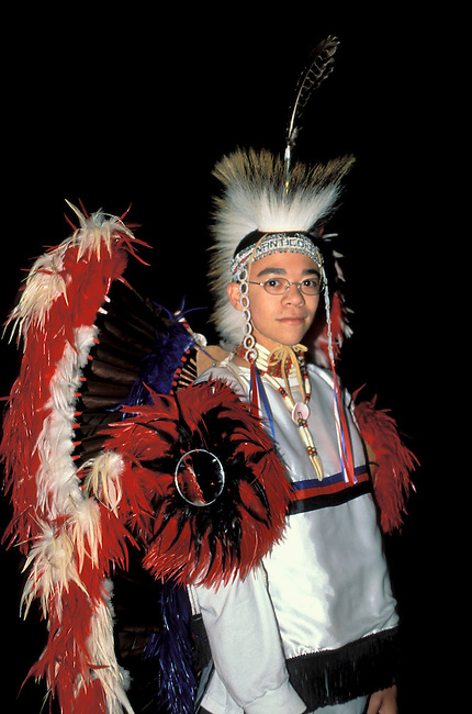 A Nanticoke fancy dancer dressed in pow wow regalia attends a dance presentation at the Nanticoke Indian Museum in Millsboro Delaware