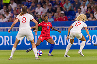 LYON,  - JULY 2: Crystal Dunn #19 passes during a game between England and USWNT at Stade de Lyon on July 2, 2019 in Lyon, France.