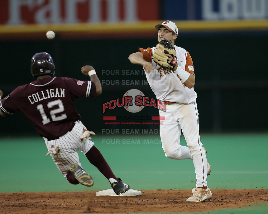 Texas 2B Travis Tucker turns a double play against Texas A&M on May 16th, 2008 in Austin Texas. Photo by Andrew Woolley / Four Seam Images..