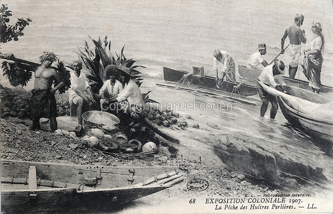 Pearl oyster fishermen from West Africa, postcard of the Colonial Exhibition of 1907, held in the Jardin d'Agronomie Tropicale, or Garden of Tropical Agronomy, in the Bois de Vincennes in the 12th arrondissement of Paris, postcard from the nearby Musee de Nogent sur Marne, France. The garden was first established in 1899 to conduct agronomical experiments on plants of French colonies. In 1907 it was the site of the Colonial Exhibition and many pavilions were built or relocated here. The garden has since become neglected and many structures overgrown, damaged or destroyed, with most of the tropical vegetation disappeared. The site is listed as a historic monument. Picture by Manuel Cohen / Musee de Nogent sur Marne