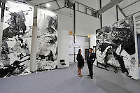 HONG KONG - MARCH 13: Two people stand among paintings 'Re-think' by Lan Zhenghui in art fair Art Central on its first day on March 13, 2015 in Hong Kong, Hong Kong.  (Photo by Lucas Schifres/Getty Images)