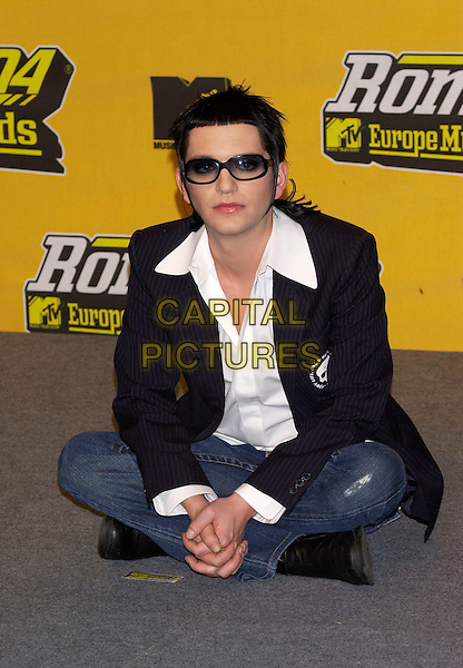 BRIAN MOLKO.MTV Europe Music Awards 2004.November 18th, 2004.full length, sitting, glasses, pinstripe jacket, cross legged.www.capitalpictures.com.sales@capitalpictures.com.©Capital Pictures