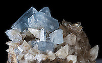 Celestine or celestite,  a pale blue mineral consisting of strontium sulfate. On a matrix with calcite. Lime City, Wood County, Ohio, USA