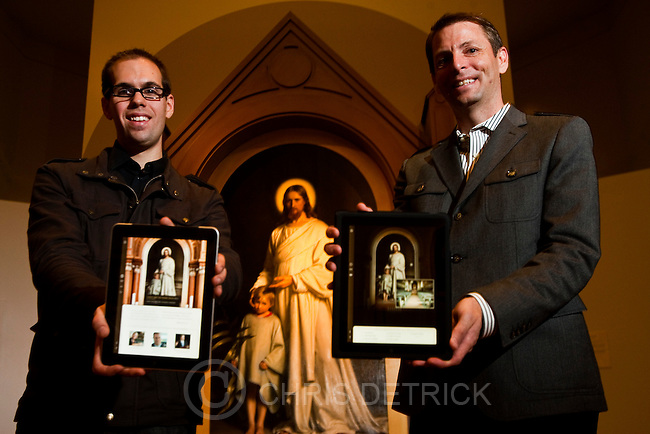 Chris Detrick  |  The Salt Lake Tribune .While holding interactive iPads, Nicolas Perner, left, and Jeff Sheets pose for a portrait in front of Danish painter Carl Bloch's 'Christ Blessing the Little Child' at the Brigham Young University Museum of Art Tuesday November 9, 2010.