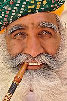 Colorful seikh smoking pipe, Jodhpur, India.