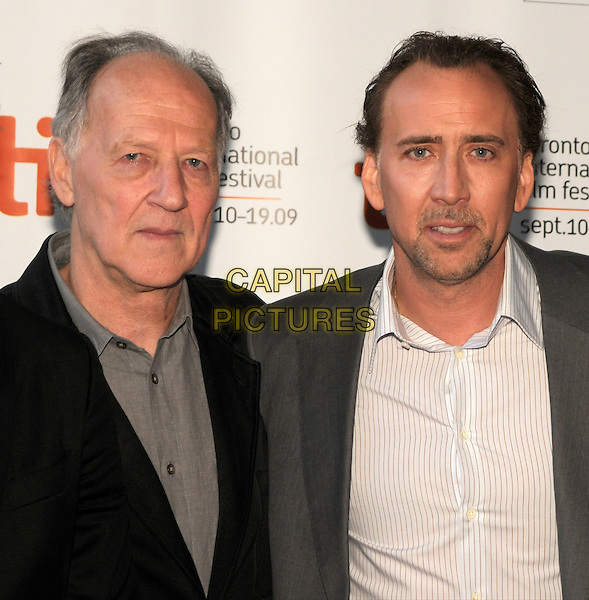 "WERNER HERZOG (director) & NICOLAS CAGE .""Bad Lieutenant: Port Of Call New Orleans"" Premiere held at the Ryerson Theatre during the 2009 Toronto International Film Festival, Toronto, Ontario, Canada, 15th September 2009..portrait headshot nicholas grey gray suit white shirt collar goatee facial hair  black.CAP/ADM/BPC.©Brent Perniac/Admedia/Capital Pictures"