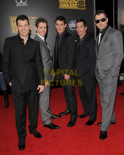 NEW KIDS ON THE BLOCK - JOEY McINTYRE, DANNY WOOD, DONNIE WALBERG, JONATHAN KNIGHT & JORDAN KNIGHT.The 2008 American Music Awards held at Nokia Theatre L.A. Live in Los Angeles, California, USA. .November 23rd, 2008 .ama amas ama's arrivals full length black grey gray suit jacket sunglasses shades nkotb.CAP/DVS.©Debbie VanStory/Capital Pictures.
