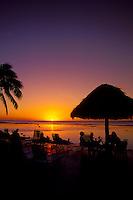 Resort beach patio at sunset, Roratonga, Cook Islands.
