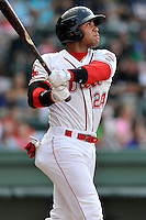 Second baseman Yoan Moncada (24) of the Greenville Drive hits a ground rule double in the first inning of a game against the Augusta GreenJackets on Thursday, July 16, 2015, at Fluor Field at the West End in Greenville, South Carolina. The Cuban-born 19-year-old Red Sox signee has been ranked the No. 1 international prospect in baseball by Baseball America. Greenville won, 11-5. (Tom Priddy/Four Seam Images)