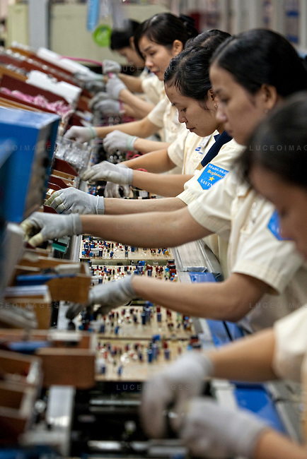 Sumsung employees assembles circuit boards for television sets at the Samsung Vina Electronics Co. factory in district Thu Duc in Ho Chi Minh City, Vietnam. Photo taken on Friday, December 4, 2009. Kevin German / Luceo Images