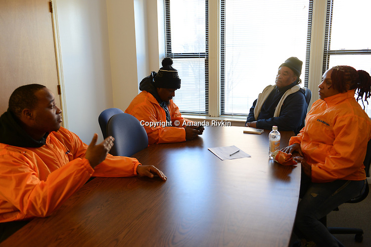 "Cease Fire outreach workers and violence interrupters (l-r) Donya Smith, 26, James Sima, 39, supervisor Ulysses ""US"" Floyd, and Jerusha ""Rue"" Hodge, 42, briefing in their office on recent developments in the neighborhoods where they work with at risk youth participants on the far South Side of Chicago, Illinois on February 3, 2017.  Cease Fire is a public health initiative that attempts to stop or halt gun violence across the city."