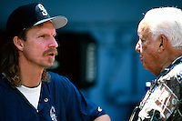 Randy Johnson of the Seattle Mariners and former USC Trojans Head Coach Rod Dedeaux before a game at Dodger Stadium in Los Angeles, California during the 1997 season.(Larry Goren/Four Seam Images)