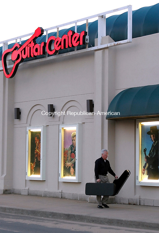 WATERBURY, CT - 23 March 2004 - 032304TH06 - Carl Fahnestock , a Glastonbury guitar player since 1975, heads into the Guitar Center in Manchester Tuesday night.  He was in search of a new electric guitar.   TODD HOUGAS PHOTO