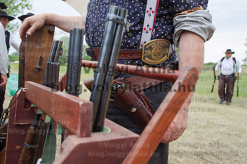 Competitor prepares during the Cowboy Action Shooting European Championship in Dabas, Hungary on August 11, 2012. ATTILA VOLGYI