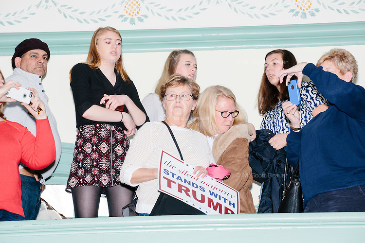 People watch as real estate mogul and Republican presidential candidate Donald Trump leaves after speaking at a rally at Exeter Town Hall in Exeter, New Hampshire, on Thurs., Feb. 4, 2016.