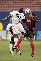 Zizi Roberts of the Rapids goes up for a header against Amado Guevara of the MetroStars. The Colorado Rapids lost to the NY/NJ MetroStars 2-1 on 5/3/03 at Giant's Stadium,East Rutherford, NJ.