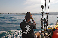 "- campaign ""Green Schooner"" for pollution monitoring in Italian seas waters, organized by enviromentalist association ""Legambiente""; schooner ""Catholica"" (year of construction 1936) approach the harbor of Valona (Albania)....- campagna ""Goletta Verde"" per monitorare l'inquinamento delle acque nei mari organizzata dall'associazione ambientalista italiana ""Legambiente""; la goletta ""Catholica"" (anno di costruzione 1936) si avvicina al porto di Valona (Albania)"