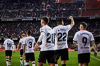 9th November 2019; Mestalla, Valencia, Spain; La Liga Football,Valencia versus Granada; Ferran Torres of Valencia CF celebrates with his team mates after scoring in minute 97' the second goal for his team (2-0) - Editorial Use