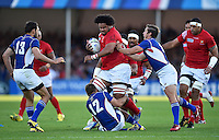 Opeti Fonua of Tonga takes on the Namibia defence. Rugby World Cup Pool C match between Tonga and Namibia on September 29, 2015 at Sandy Park in Exeter, England. Photo by: Patrick Khachfe / Onside Images