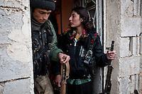 SYRIA: YPJ and YPG are preparing to go on the first front line of the cement plant located 6km from the town of Tal Abyad.<br /> <br /> SYRIA: YPG et YPJ s'apprêtent à se rendre surla première ligne de front de la cimenterie située à 6km de la ville de Tal Abyad.