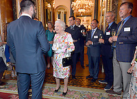 14 July 2016 - Queen Elizabeth II speaks to guests during a reception for the winners of  The Queen's Awards for Enterprise 2016 at Buckingham Palace in central London. Winners of The Queen's Awards for Enterprise 2016 which recognise excellence in international trade, innovation and sustainable development were joined by the Queen at the celebration on Thursday evening. More than 500 guests, including representatives from 254 winning companies, were at the event. Photo Credit: ALPR/AdMedia