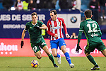 Alex Alegria (l) of Real Betis Balompie battles for the ball with Diego Roberto Godin Leal (c) of Atletico de Madrid during their La Liga 2016-17 match between Atletico de Madrid vs Real Betis Balompie at the Vicente Calderon Stadium on 14 January 2017 in Madrid, Spain. Photo by Diego Gonzalez Souto / Power Sport Images