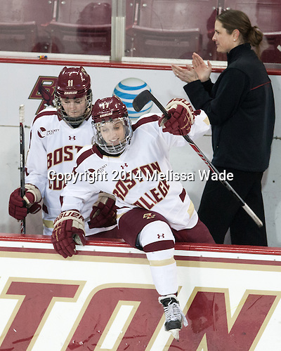 Lauren Wedell (BC - 11), Meghan Grieves (BC - 17), Katie King Crowley (BC - Head Coach) - The Boston College Eagles celebrate winning the 2014 Beanpot championship on Tuesday, February 11, 2014, at Kelley Rink in Conte Forum in Chestnut Hill, Massachusetts.