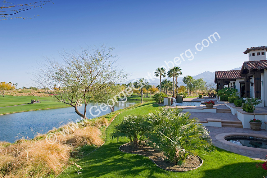 Beautiful backyard with swimmingpool overlooking small lake and golf course