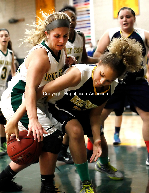 Waterbury, CT- 16 December 2014-121614CM10-   Holy Cross' Casey DiZinno, left, and Kennedy's Emani Covington battle for the ball during their NVL matchup in Waterbury on Tuesday.   Christopher Massa Republican-American
